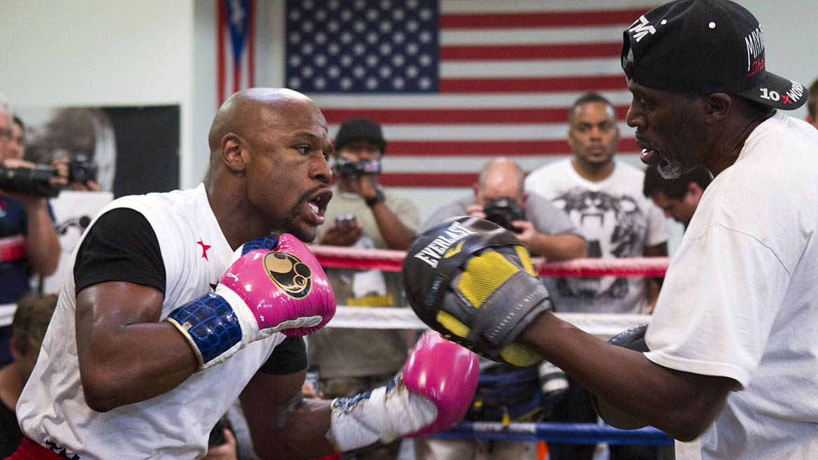 WBC welterweight champion Floyd Mayweather Jr. of the U.S. works on his timing with his uncle and trainer Roger Mayweather at the Mayweather Boxing Club in Las Vegas, Nevada