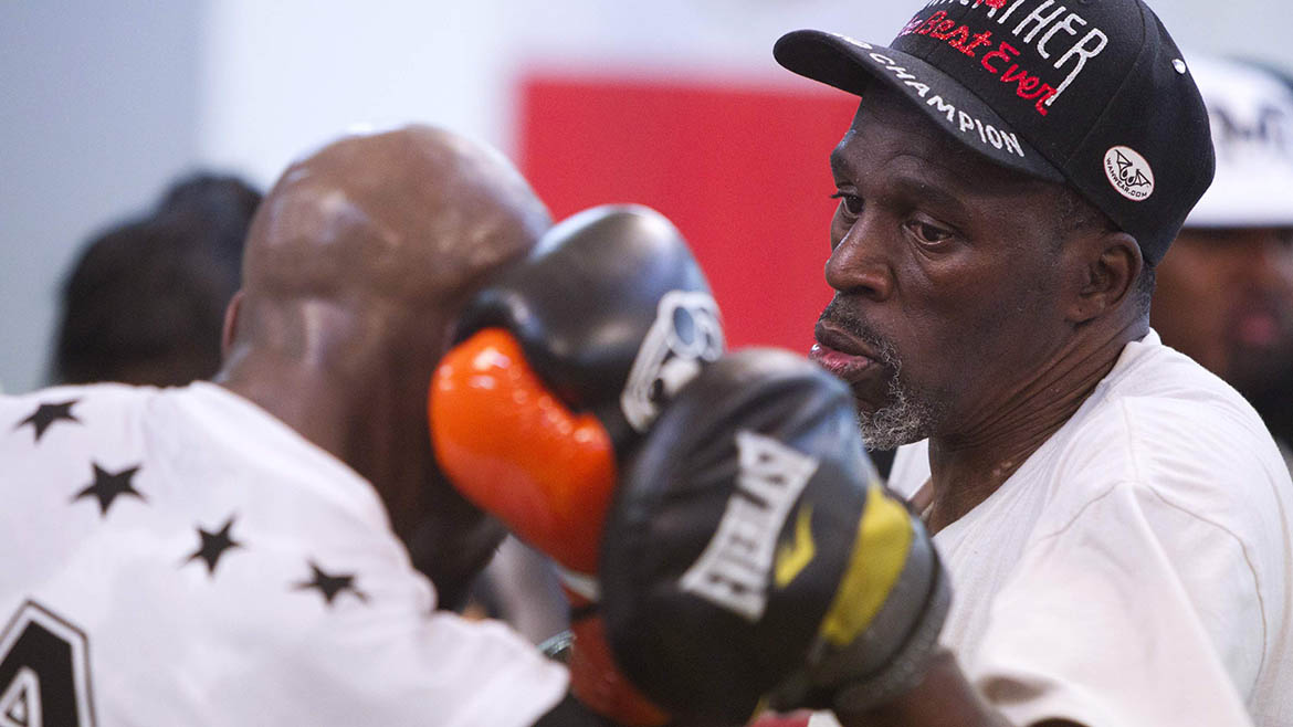 WBC welterweight champion Floyd Mayweather Jr. of the U.S. works on his timing with his uncle and trainer Roger Mayweather at the Mayweather Boxing Club in Las Vegas