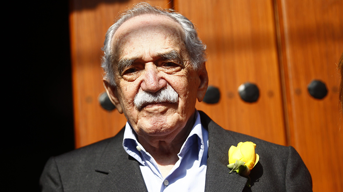 Colombian author Gabriel Garcia Marquez stands outside his house on his 87th birthday in Mexico City