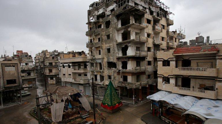 Siria: La ciudad de Homs devastada por bombardeos también festejó