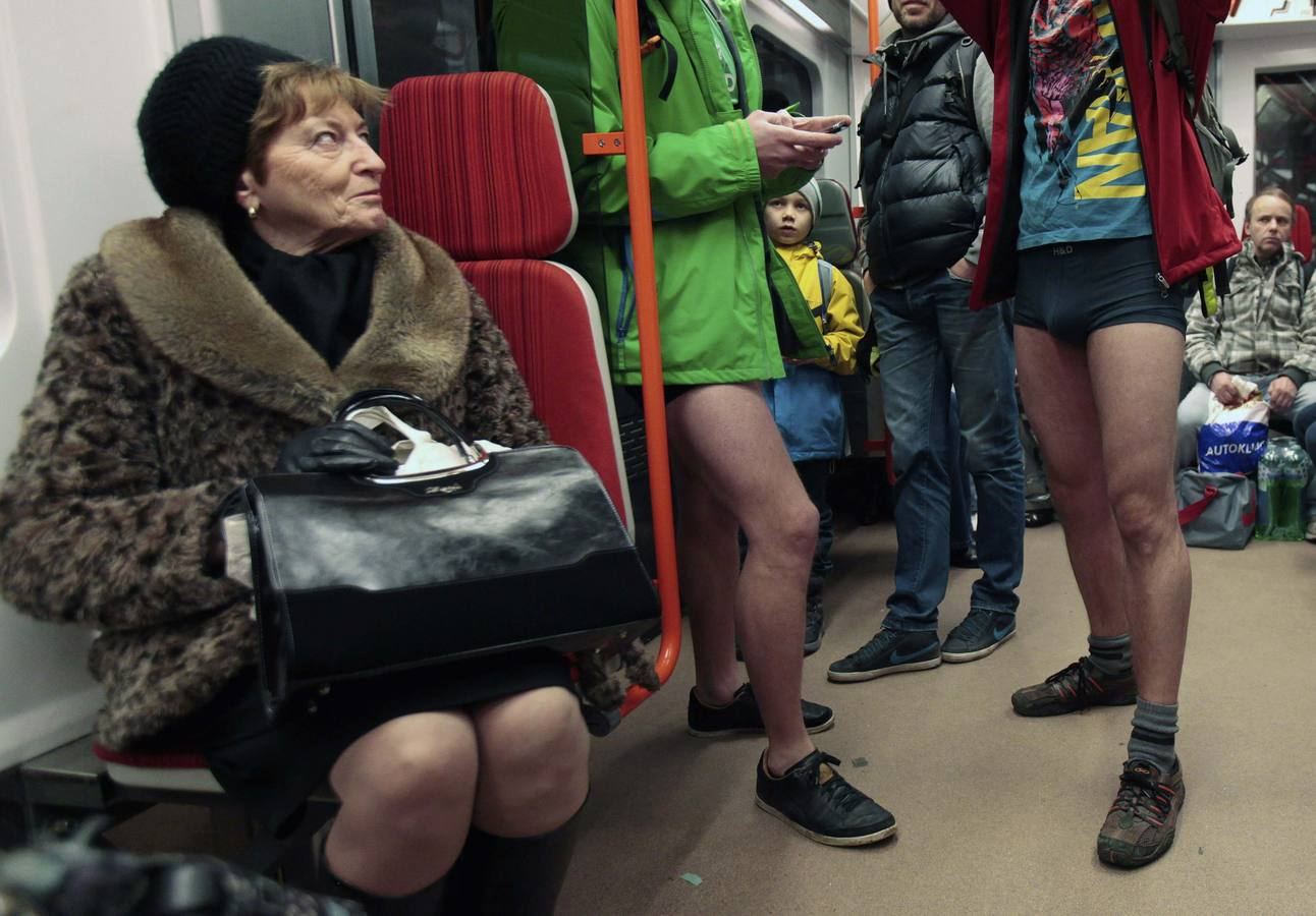 "Passengers not wearing pants stand in a subway train during the ""No Pants Subway Ride"" in Prague"