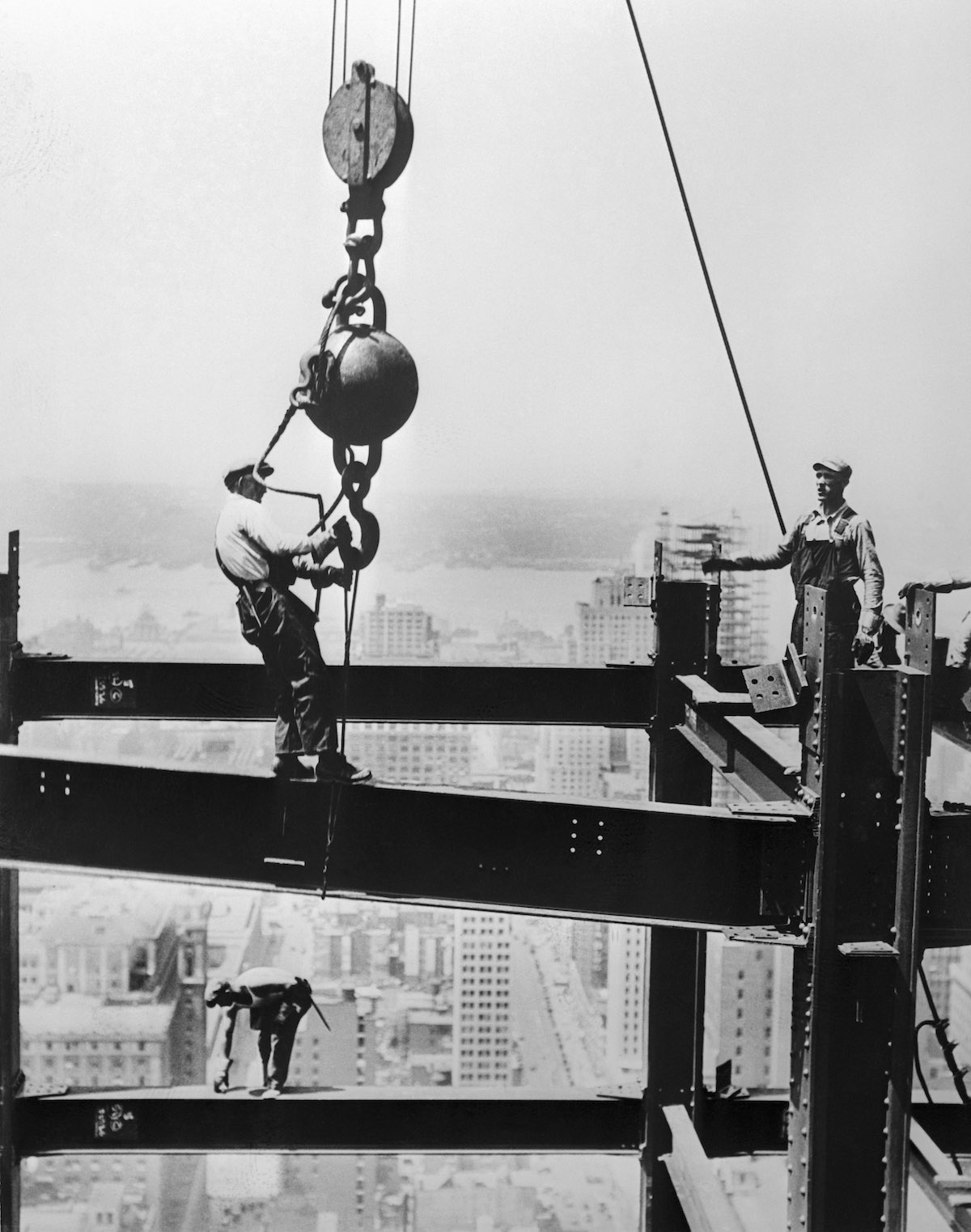 Men on Beams in Air at Construction Site
