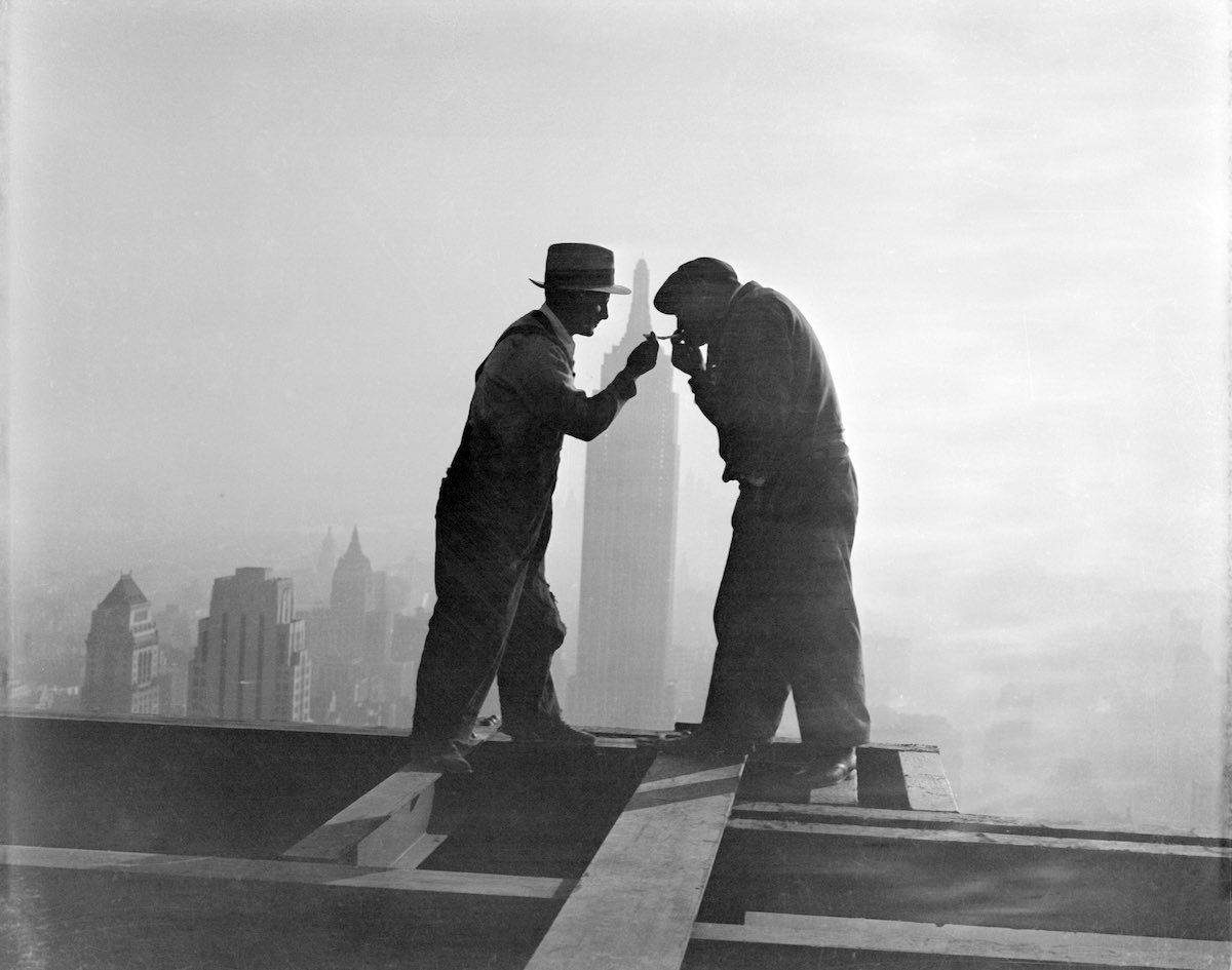 Workers Sharing Cigarettes on Skyscraper Beam