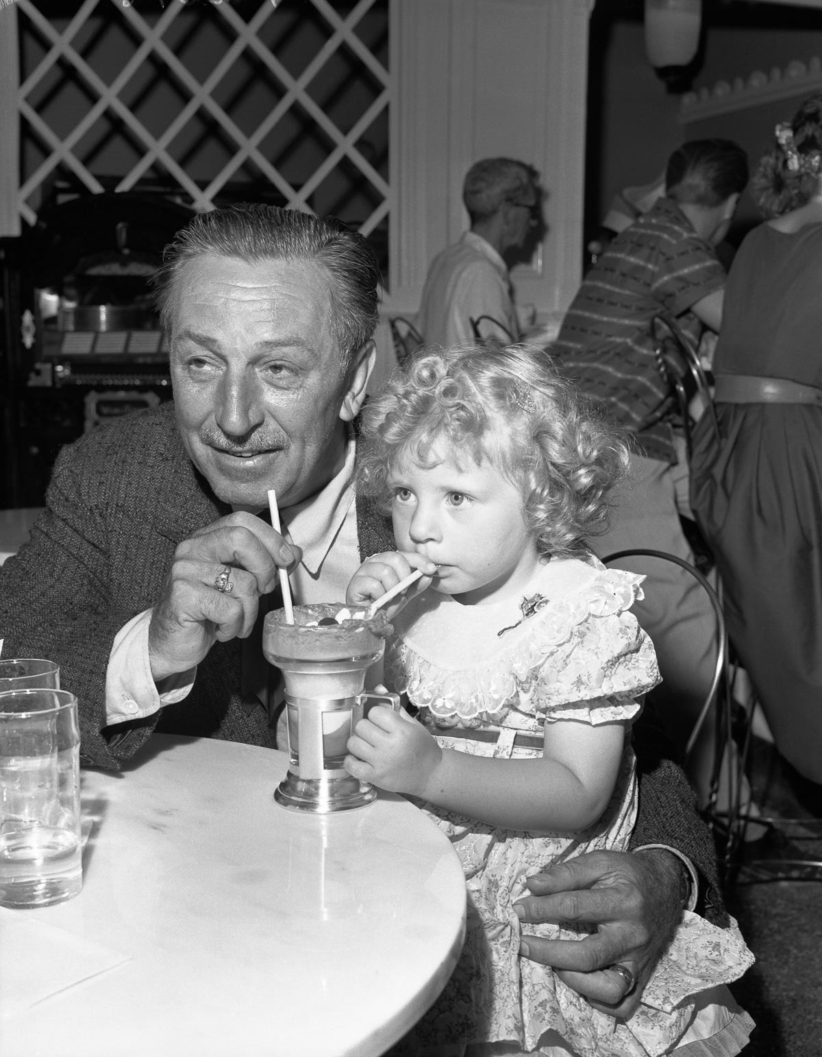 Walt Disney Sharing Ice Cream Soda with Little Girl