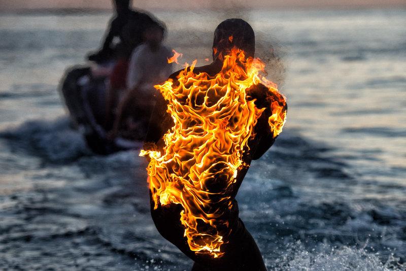 jamie-obrien-teahupoo-llamas-fuego