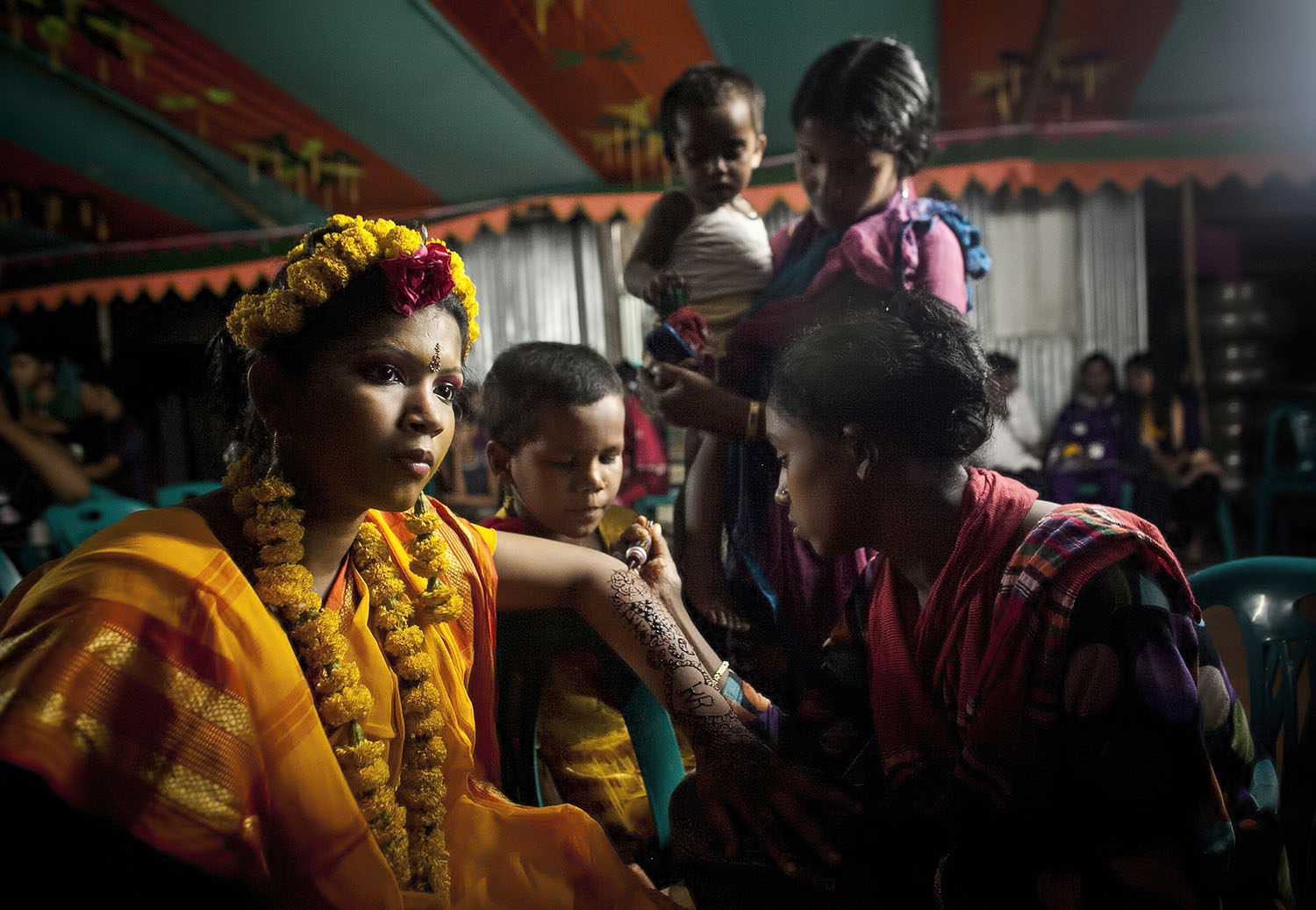 13 year old Runa Akhter is dressed for her holud ceremony the night before her wedding to a 29 year old man