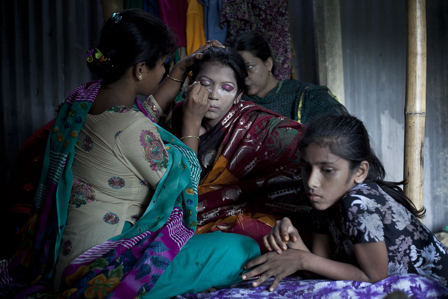 13 year old Runa Akhter has her makeup done by her friends the day of her wedding to a 29 year old man
