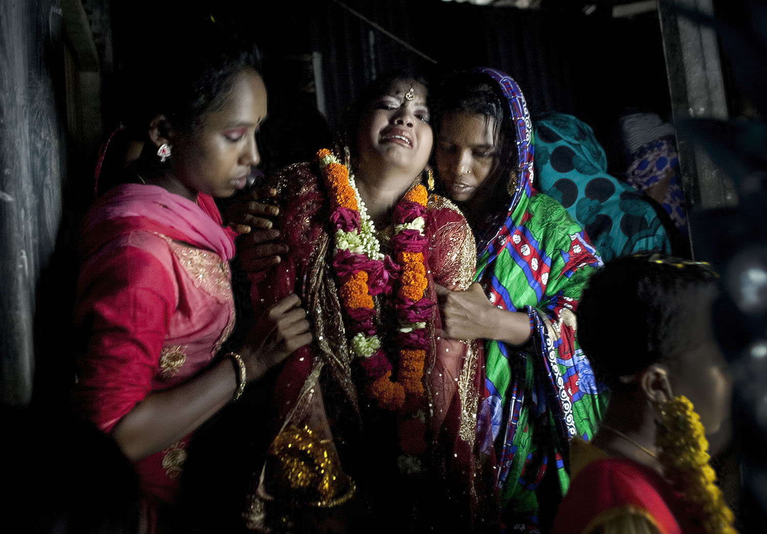 13 year old Runa Akhter cries as she is led to her new husband, the day of her wedding to a 29 year old man