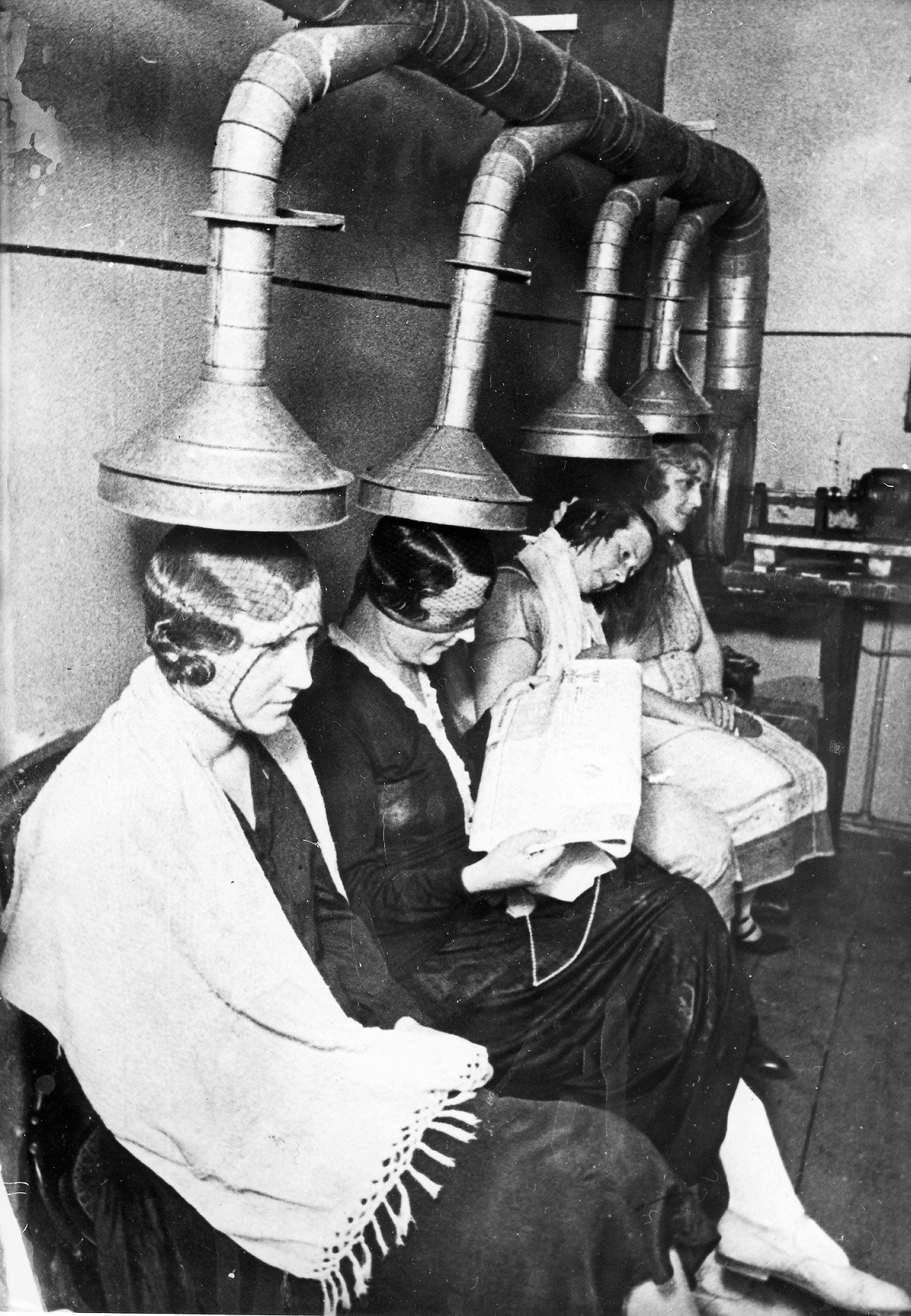 Russia; Moscow; women sitting under a hair dryer in a hairdresser; taken by Emil Strassberg - 1933