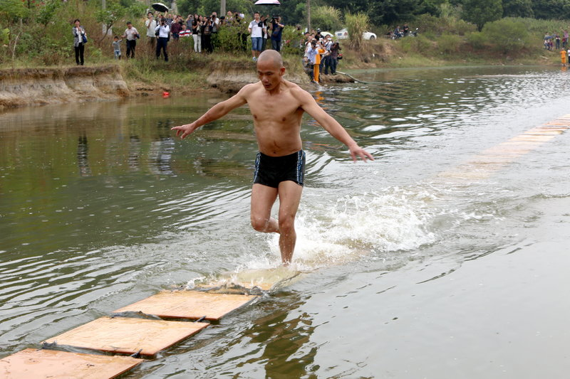 Shaolin Monk Perfroms Water Run In Quanzhou