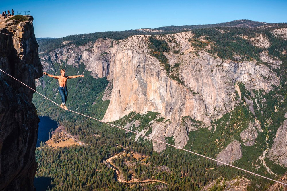 A highliner freesoloing in Yosemite.