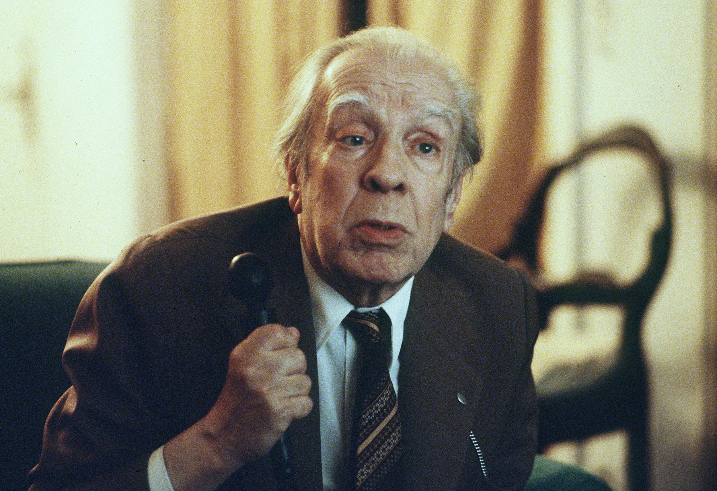 FILE - In this Nov. 20, 1981 file photo, Argentina's writer Jorge Luis Borges talks in his Buenos Aires apartment. Borges, Julio Cortazar, and Juan Gelman, three exiled Argentine greats of twentieth century Hispanic literature were deeply committed to their country. However all three died on foreign soil. Cortazar died in Paris in 1984, Borges in Geneva two years later and Gelman in Mexico City in early 2014. (AP Photo/Eduardo Di Baia, File)