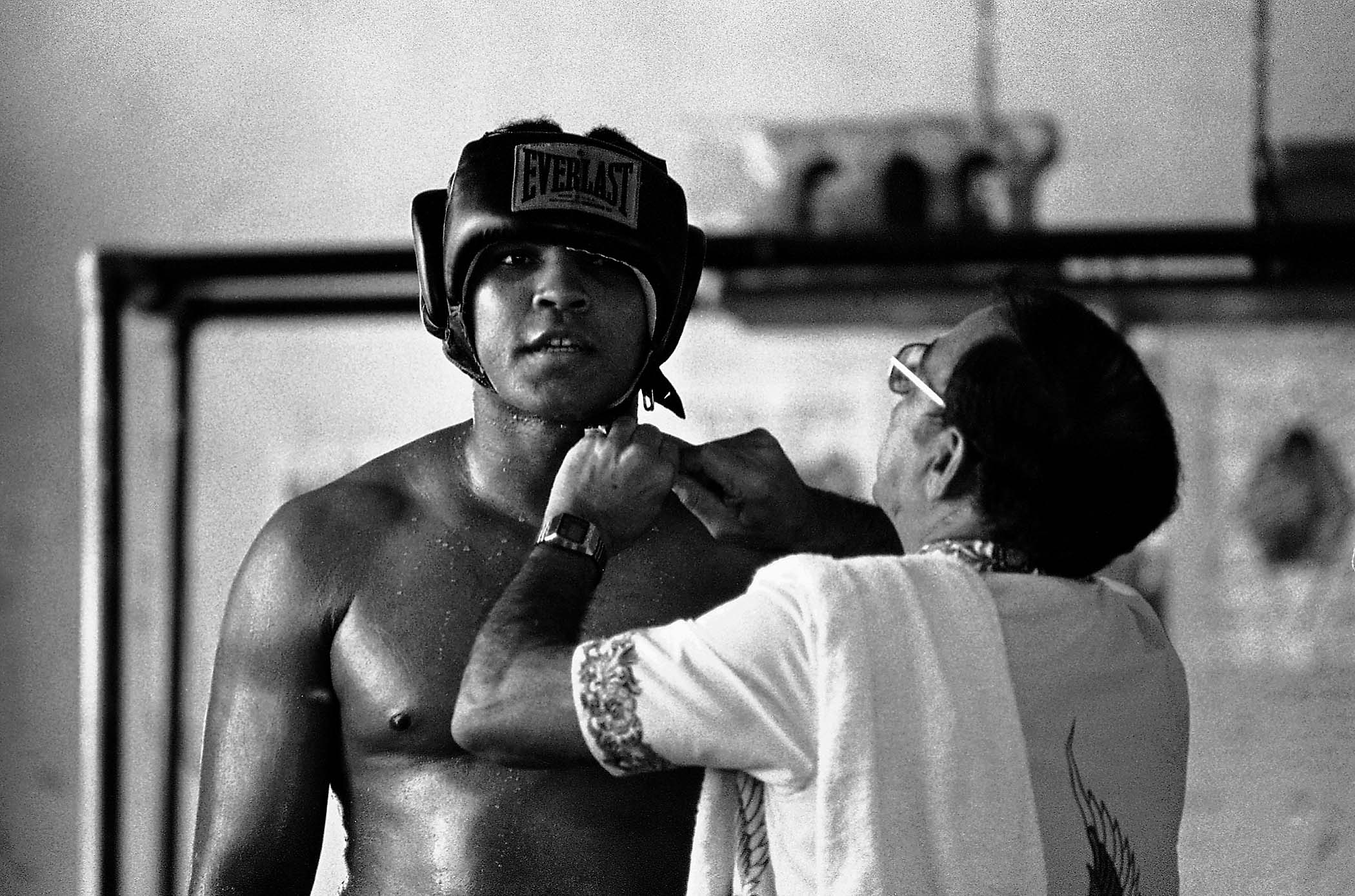 World heavyweight champion Muhammad Ali has his head gear adjusted by trainer Chris Dundee at the 5th Street Gym in December, 1977. Ali was preparing for his  fight against Olympic gold medalist Leon Spinks, which he lost on February 15, 1978 in Las Vegas. Ali went on the reclaim the title in a rematch later that year. (Associated Press)