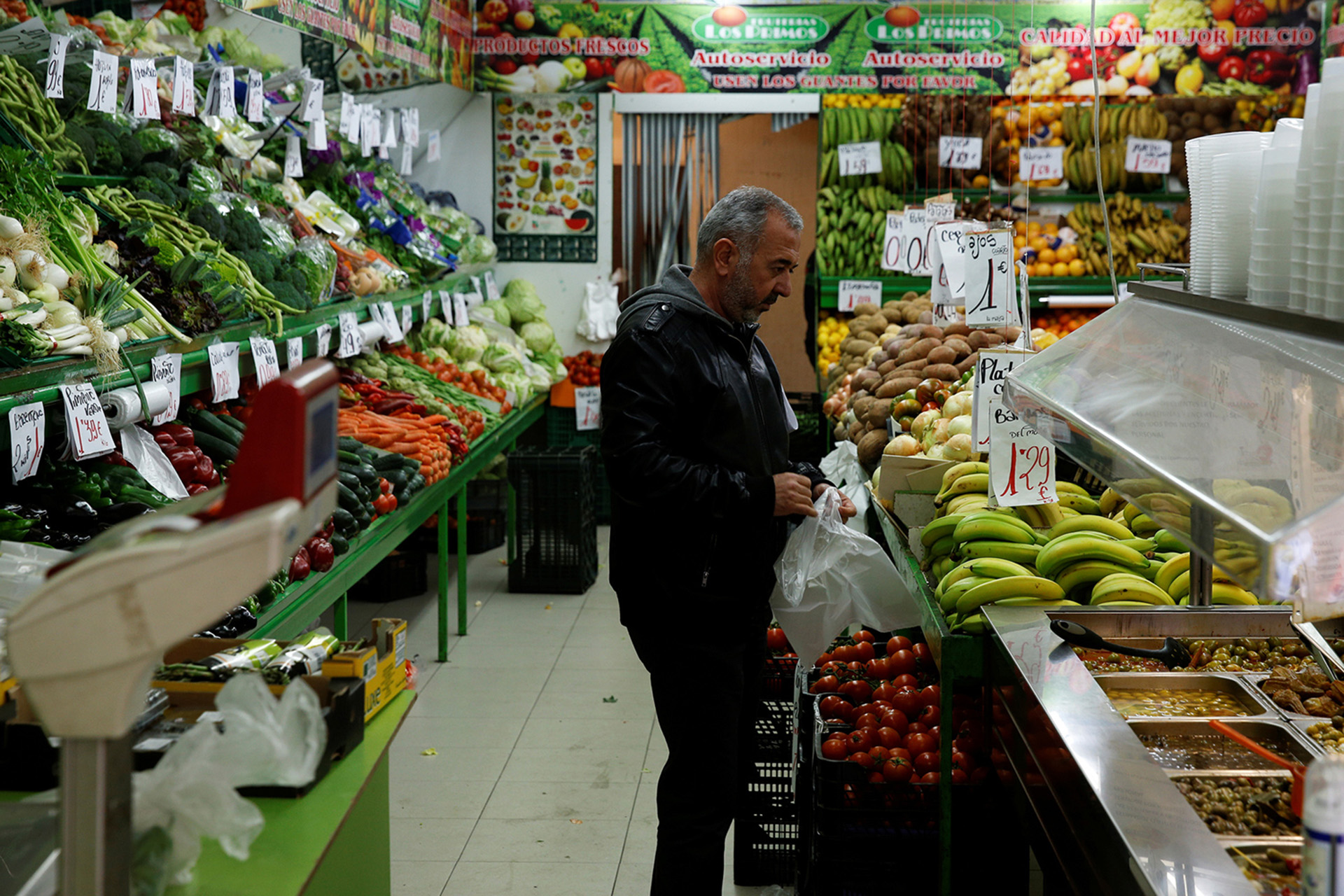 "Osama Abdul Mohsen, a Syrian refugee, buys bananas at a fruit shop near his home in Getafe, outside Madrid, Spain, April 14, 2016. Mohsen's story went viral after he was filmed being tripped up by a camerawoman as he fled police near the Hungarian border with Serbia last September. He was carrying his youngest son Zaid in his arms at the time, and the two fell sprawling on the ground. Footage of the incident helped bring him to the attention of a soccer training school in Getafe on the outskirts of Madrid, which found him work as a liaison officer. REUTERS/Sergio Perez     SEARCH ""REFUGEE PEREZ"" FOR THIS STORY. SEARCH ""THE WIDER IMAGE"" FOR ALL STORIES   - RTX2CXBT"