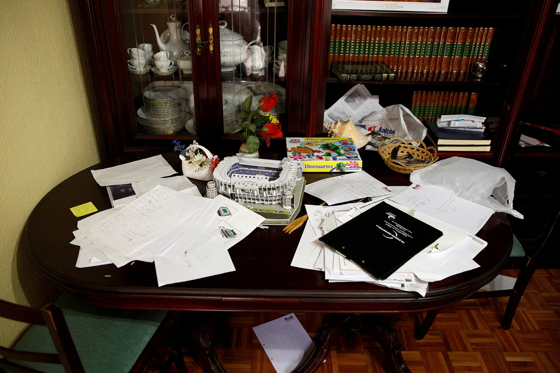 "A Spanish encyclopaedia, a model of Santiago Bernabeu stadium and Spanish homework papers are seen on a table inside the home of Osama Abdul Mohsen, a Syrian refugee, in Getafe, outside Madrid, Spain, April 21, 2016. Mohsen's story went viral after he was filmed being tripped up by a camerawoman as he fled police near the Hungarian border with Serbia last September. He was carrying his youngest son Zaid in his arms at the time, and the two fell sprawling on the ground. Footage of the incident helped bring him to the attention of a soccer training school in Getafe on the outskirts of Madrid, which found him work as a liaison officer. REUTERS/Sergio Perez     SEARCH ""REFUGEE PEREZ"" FOR THIS STORY. SEARCH ""THE WIDER IMAGE"" FOR ALL STORIES   - RTX2CXCT"