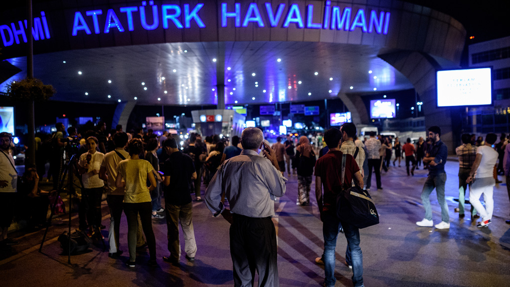 People wait outside the Ataturk airport in Istanbul, on June 28, 2016, after two explosions followed by gunfire hit the Turkey's biggest airport, killing at least 10 people and injured 20.
