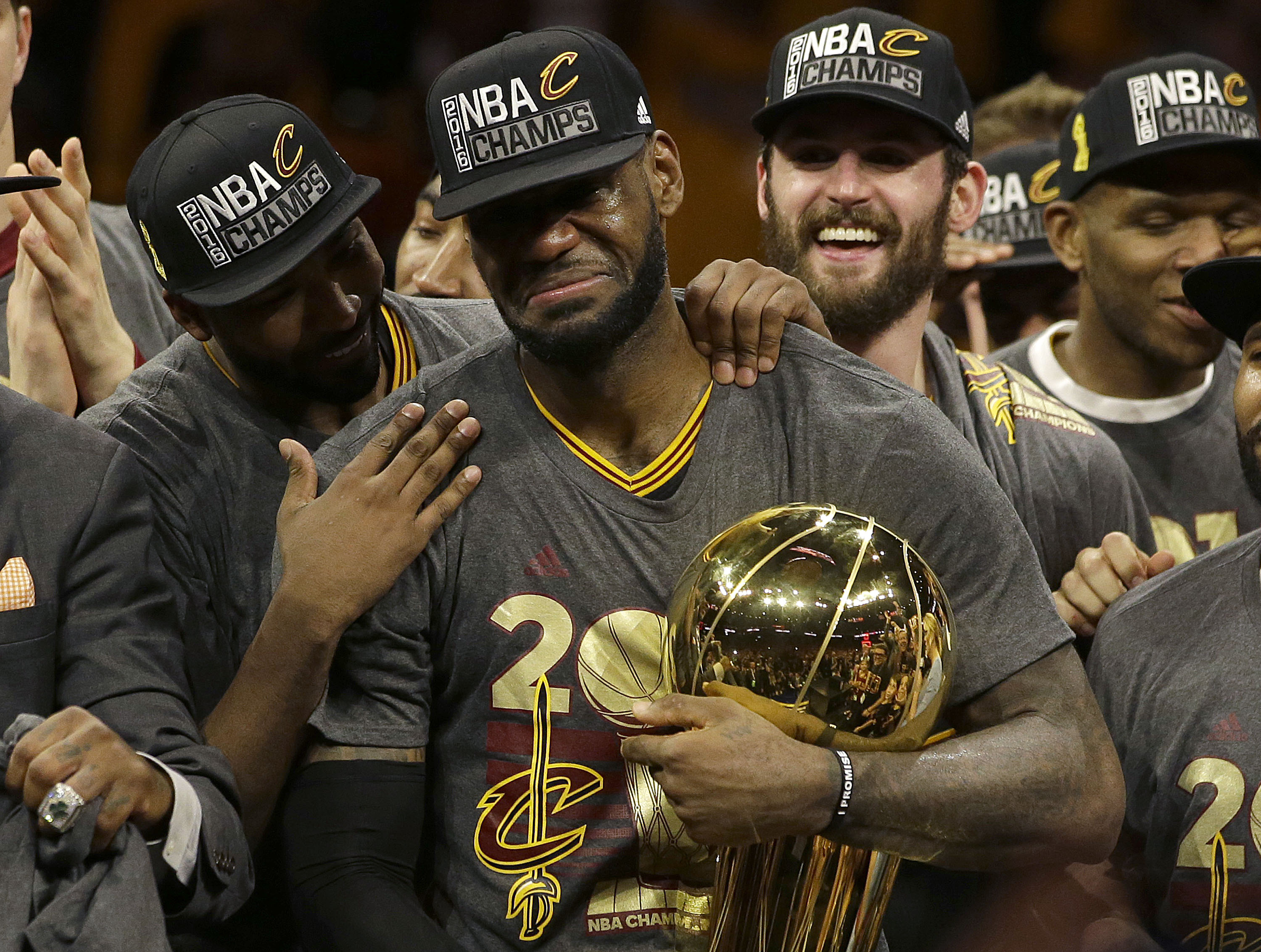 Cleveland Cavaliers forward LeBron James, center, celebrates with teammates after Game 7 of basketball's NBA Finals against the Golden State Warriors in Oakland, Calif., Sunday, June 19, 2016. The Cavaliers won 93-89. (AP Photo/Marcio Jose Sanchez)