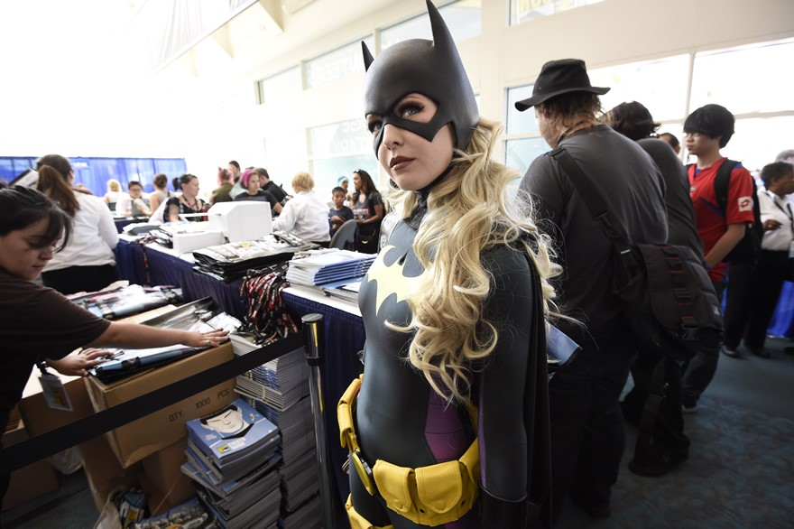 Jessica Chancellor, dressed as Batgirl, waits in line for her credential on Preview Night at Comic-Con International held at the San Diego Convention Center Wednesday, July 20, 2016, in San Diego.  (Photo by Denis Poroy/Invision/AP)