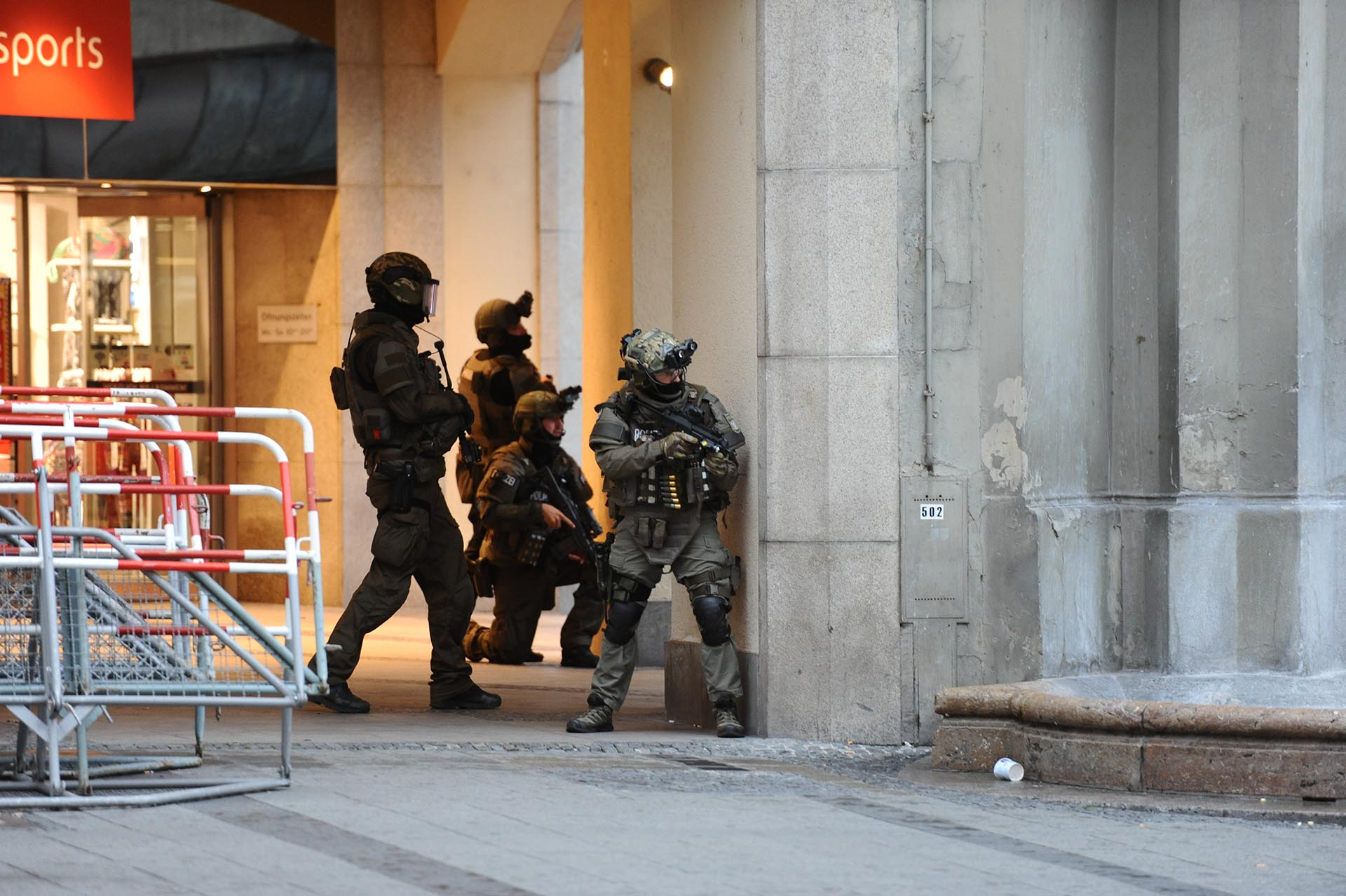 Heavily armed police forces operate at Karlsplatz (Stachus) square after a shooting in the Olympia shopping centre was reported in Munich, southern Germany, Friday, July 22, 2016. (Andreas Gebert/dpa via AP)
