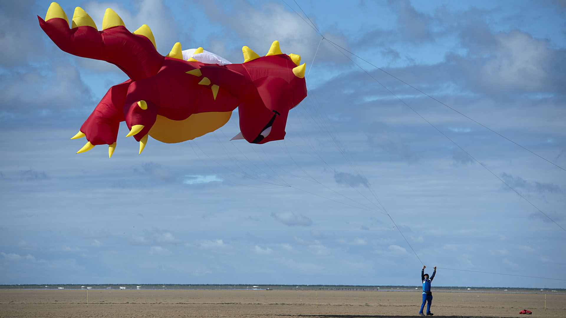 Kite enthusiasts participate in the St Annes Kite Festival on the seafront in Lytham St Annes, north west England on July 30, 2016. / AFP PHOTO / OLI SCARFF
