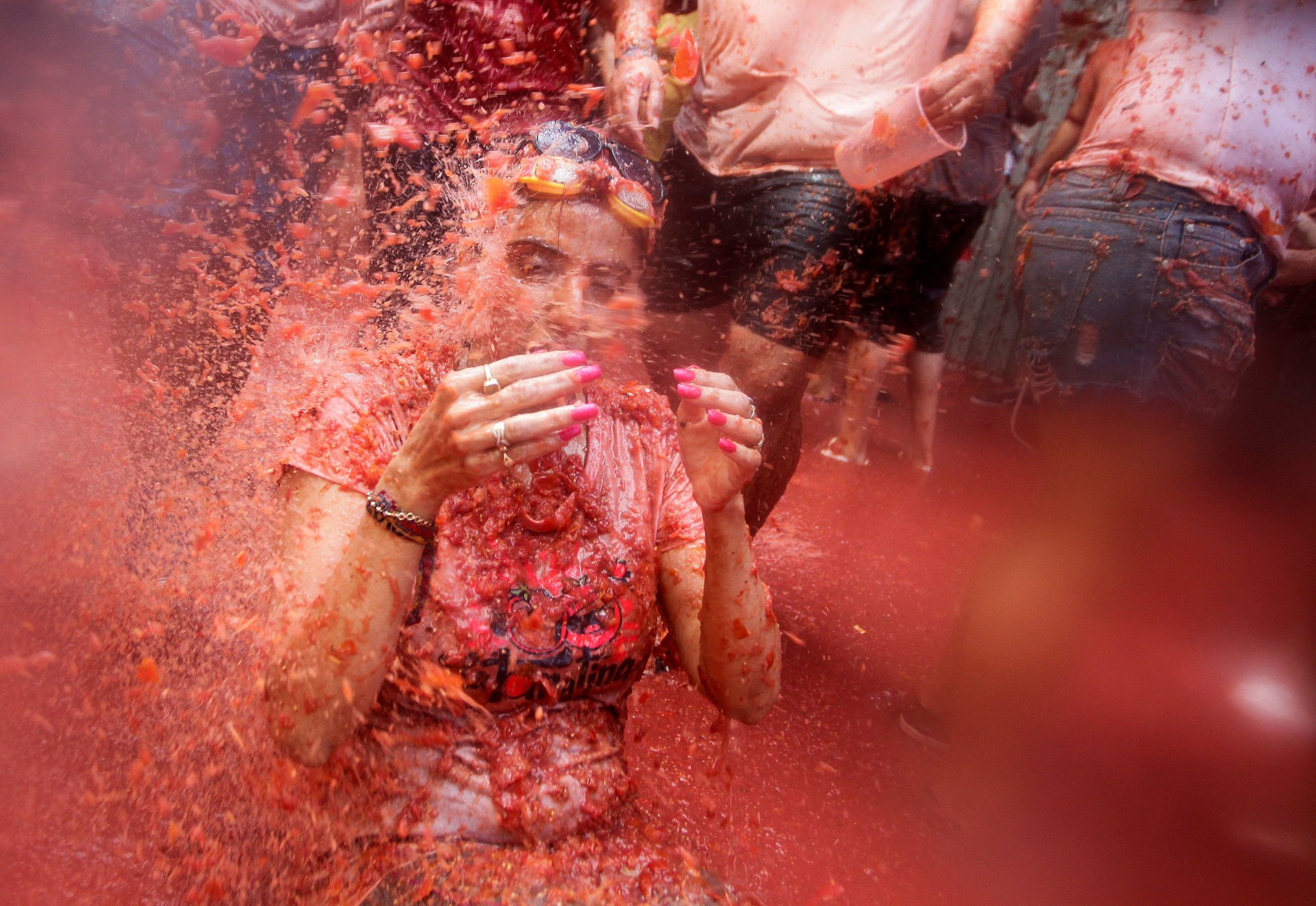 A reveller is covered with tomato pulp during the annual 'Tomatina' festival in Bunol near Valencia