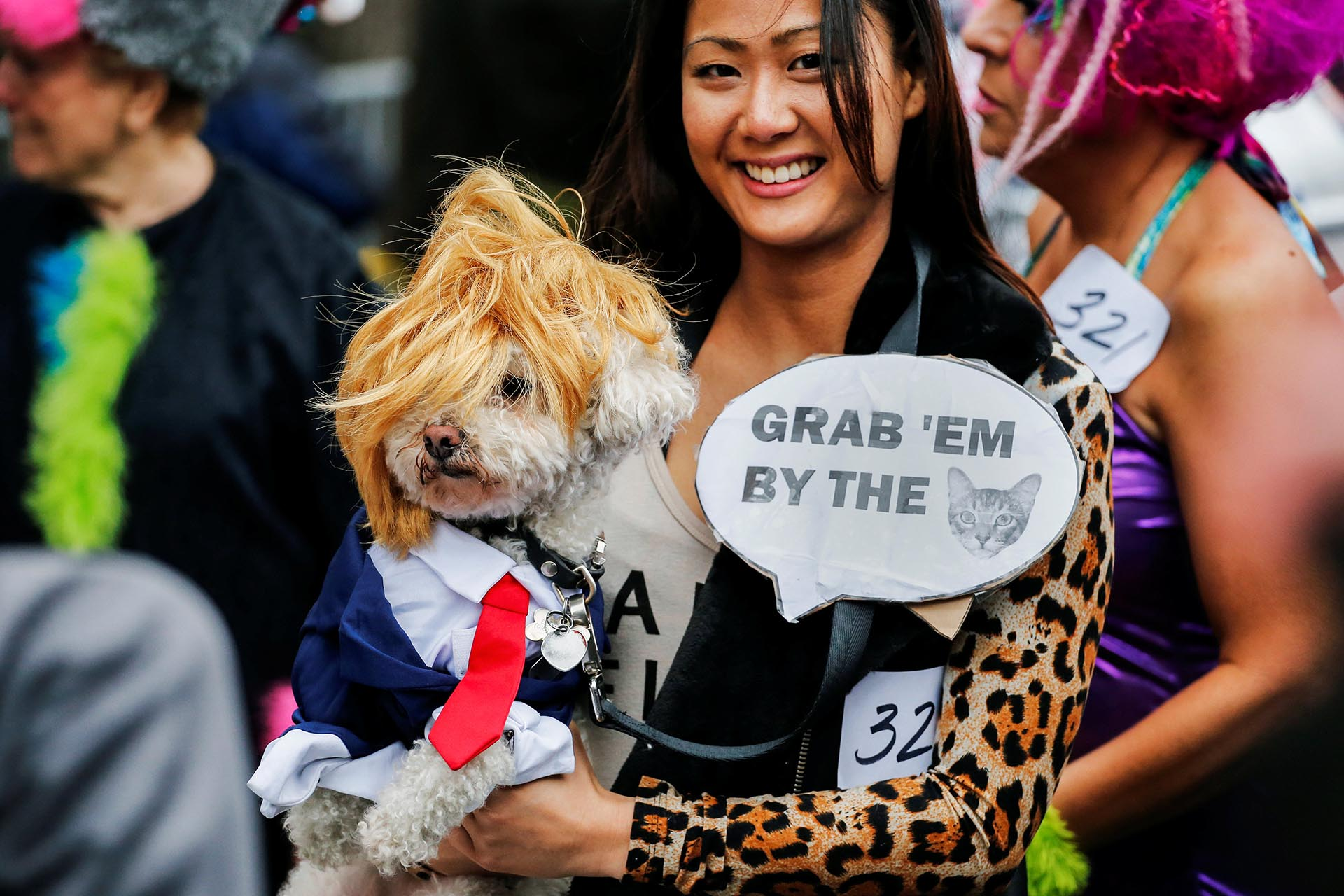 A reveller carries her dog which is depicted as Republican U.S. presidential nominee Donald Trump during the annual halloween dog parade at Manhattan's Tompkins Square Park in New York