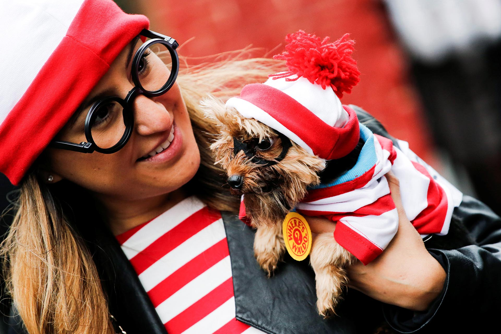 A reveller takes part in the annual halloween dog parade at Manhattan's Tompkins Square Park in New York