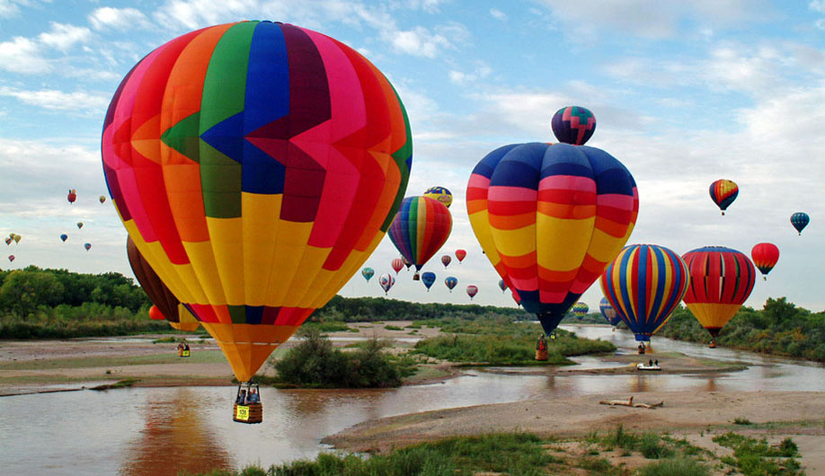 Hot-Air-Balloons-Over-A-River-During-Albuquerque-Balloon-Festival