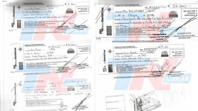 Tres de los 96 cheques emitidos por el Banco Santander, con la firma de Martín Báez.