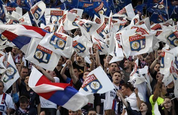 Olympique Lyon fans cheer before their Champions League semi-final second leg soccer match against Bayern Munich in Lyon