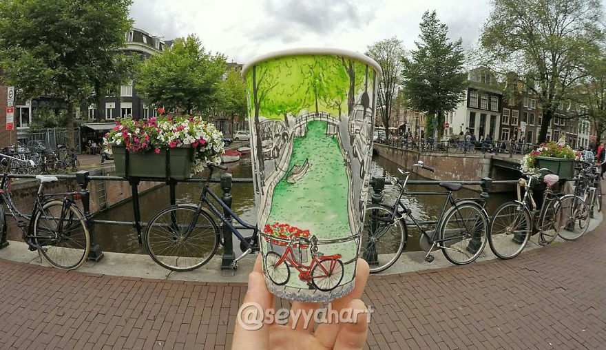 Artist-travels-the-world-and-uses-paper-coffee-cups-as-his-canvas-to-reflect-what-he-sees-59759d5ee03fd__880