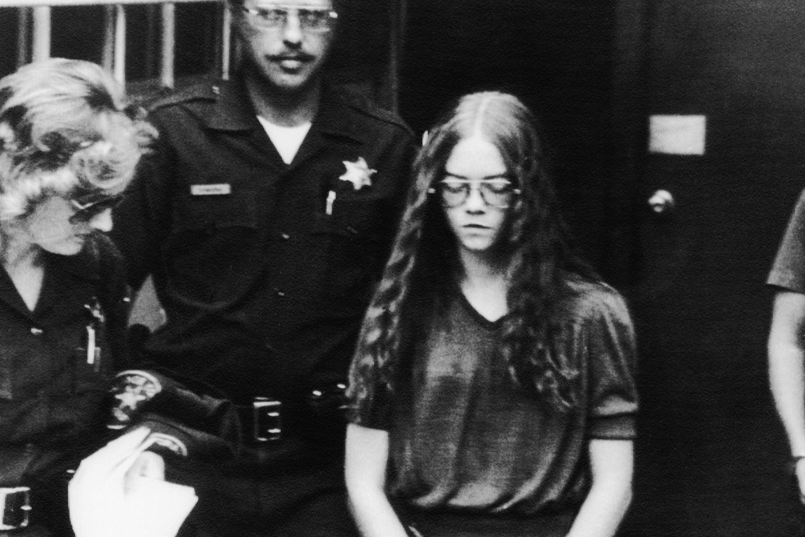 01 Oct 1979, Santa Ana, California, USA --- Brenda Spencer chained at her hands and ankles leaves the courthouse, escorted by sheriff?s deputies. Spencer pleaded guilty to two counts of first degree murder in the school yard sniper attack in San Diego that killed two men, the principal and the custodian of the elementary school, and wounded eight children and a policeman. --- Image by © Bettmann/CORBIS