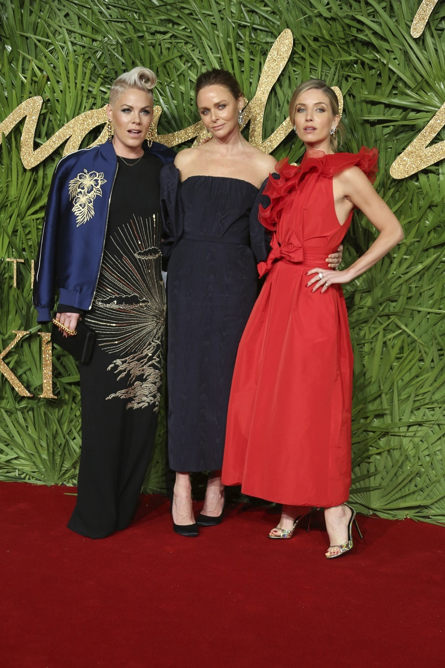 Pink, Stella McCartney and Annabelle Wallis pose upon arrival at The British Fashion Awards 2017 in London, Monday, Dec. 4th, 2017.