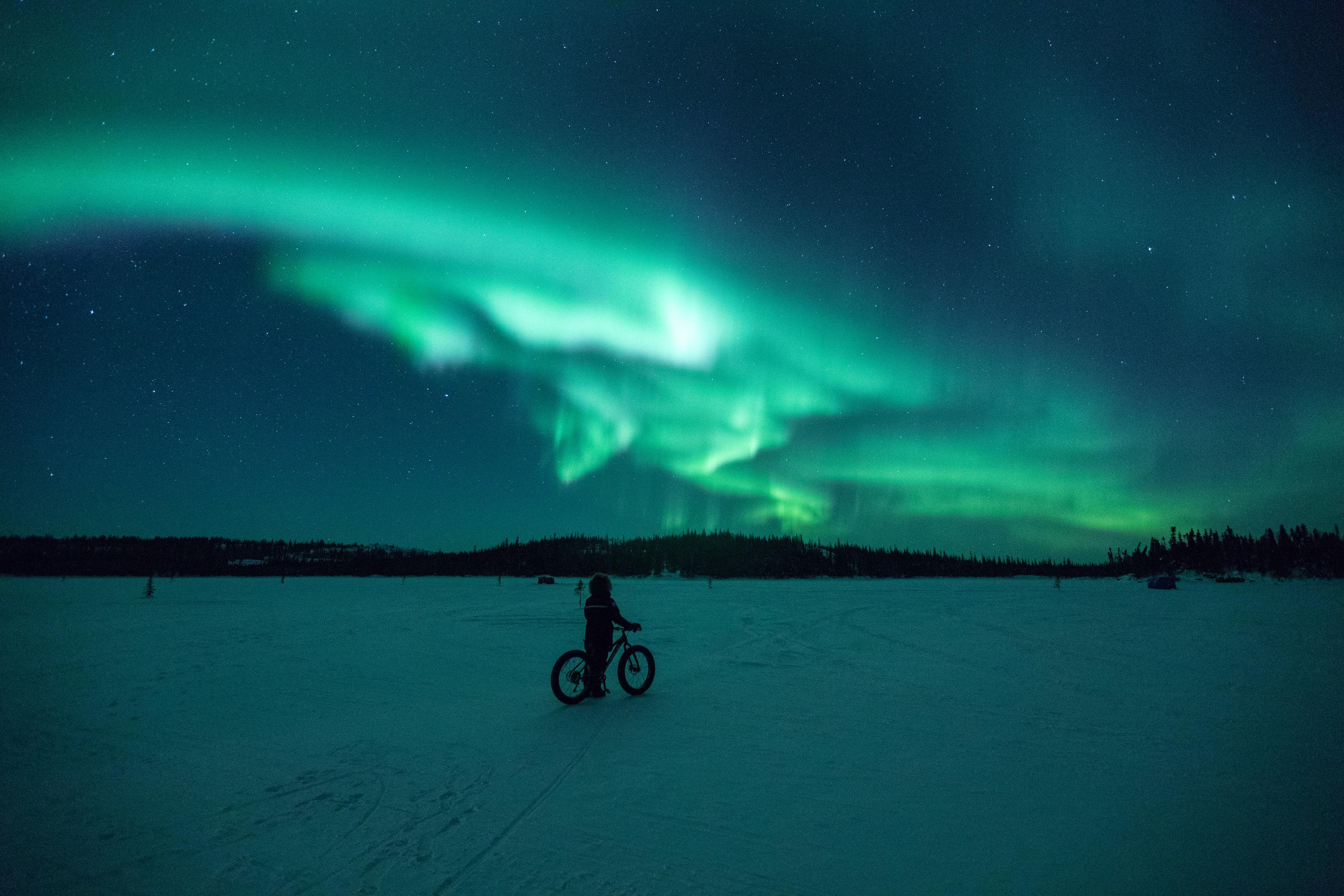 Cycling Beneath Northern Lights