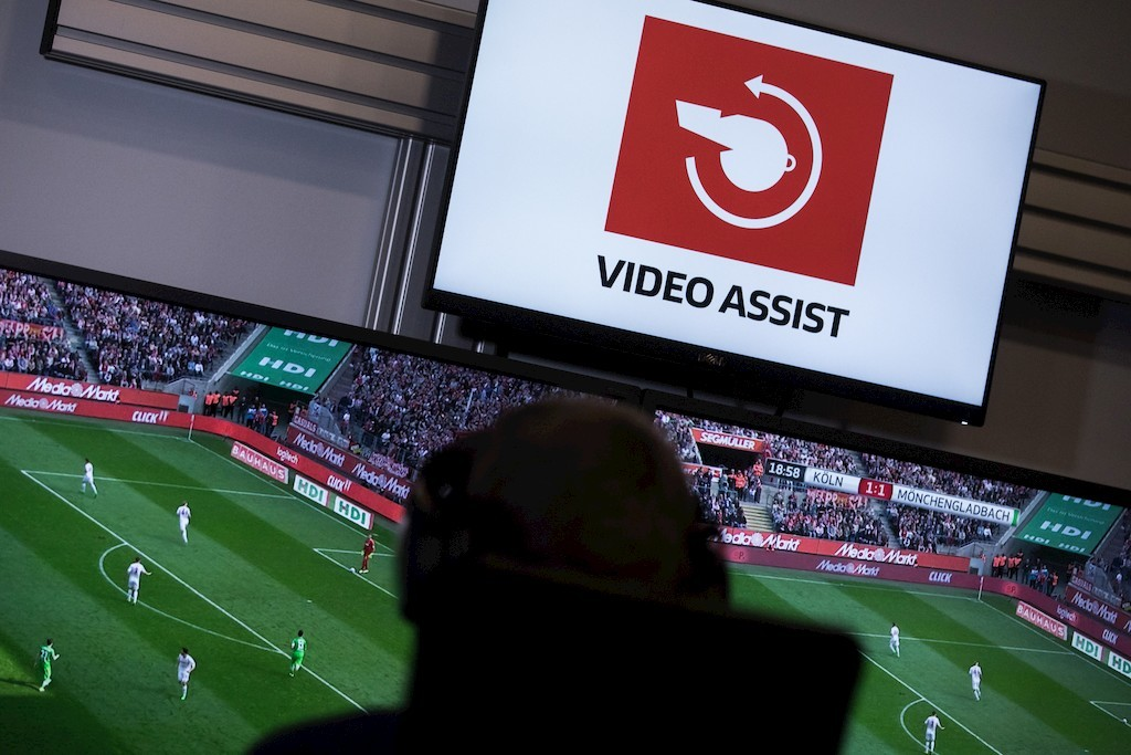 Referee Sascha Stegemann sits in front of screens showing match sequences in a video assistant referee centre in Cologne,Ge